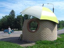 Bus stop in the form of an umbrella, Vyazma, Smolensk region. Vyazma, Russia, July 12, 2014: Bus stop in the form of an umbrella, Vyazma, Smolensk region royalty free stock photography
