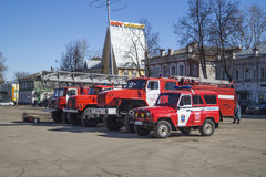 Vyazniki,Russia-March 27,2015: Fire truck cost(stand) on Cathedral area in city Vyazniki,Russia. Vyazniki,Russia-March 27,2015: Calculation of the fire truck of Stock Image