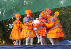 Vyaznikovskiy theatre of the baby mode on scene at day of the ci. Children in beautiful orange suit emerge on scene at day of the city Mstyora Royalty Free Stock Photo