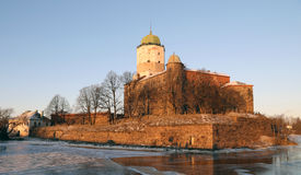 Vyborg Castle. View of the Vyborg Castle lit with the setting sun Royalty Free Stock Photos
