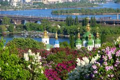 Vydubychi Monastery with lilac blossom in Kyiv, Ukraine Stock Images