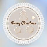 Vykortet för glad jul med vit snör åt doilypepparkakan, & kakor på en ljus blå bokeh fördunklar bakgrund stock illustrationer