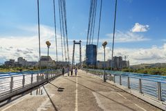 Vynogradovskiy Bridge across the Yenisei river. Cable-stayed bridge to Tatyshev island. Krasnoyarsk, Russia. Krasnoyarsk, Russia- August 9, 2017: Vynogradovskiy Stock Images