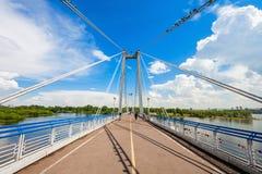 Vynogradovskiy Bridge in Krasnoyarsk. Vynogradovskiy Bridge is a cable-stayed bridge over the canal of the Yenisei, leads to Tatyshev island in Krasnoyarsk Stock Images