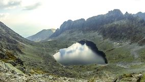 Vysne Wahlenbergovo Pleso in High Tatras, Slovakia. Hiking in High Tatras Mountains, Slovakia. Vysne Wahlenbergovo Pleso Lake 2154m. Mounts Ostra 2351m on the stock video footage