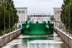 Vytegra, Russia - August 16, 2015: Cargo ship entered the White Sea-Baltic Canal Gateway. It connects the White Sea, in the Arctic royalty free stock images