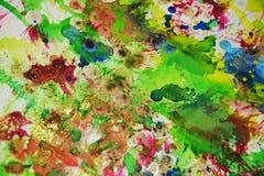Wächserne grüne Orange spritzt, abstrakter kreativer Hintergrund der Farbe Lizenzfreies Stockfoto