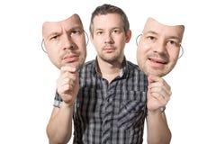 Wählen eines Gesichtes für den Tag stockfotografie