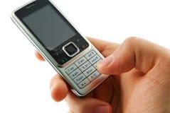 Wählen eines Handys auf einem weißen Hintergrund Stockfotografie