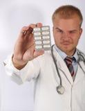 Wählen Sie eine Pille Stockfoto