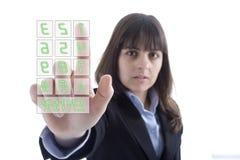 Wählende Zahlen der Geschäftsfrau Stockbild