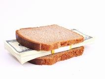 Währungssandwich auf einem weißen Hintergrund stockfotografie