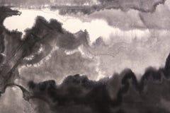 Wäsche, die grauen Hintergrund malt Stockbild