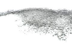 Wässern Sie Spritzen und Blasen die Bewegung auf weißem Hintergrund Lizenzfreie Stockfotos