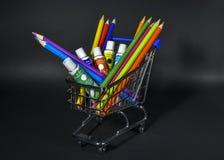 Wózek na zakupy folował z artystycznymi towarami dla rysować na czerń plecy zdjęcia royalty free