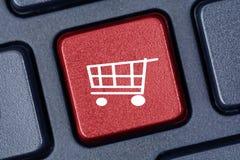 Wózek na zakupy kształt na klawiaturowym guziku Obraz Stock