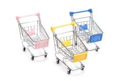 Wózek na zakupy na bielu Zdjęcia Royalty Free