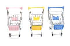 Wózek na zakupy na bielu Fotografia Stock