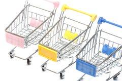 Wózek na zakupy na bielu, zbliżenie Zdjęcia Stock