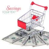 Wózek Na Zakupy na Dolarowych rachunkach odizolowywających na bielu. Ttrolley na pieniądze Obrazy Royalty Free