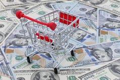 Wózek na zakupy na pieniądze Zdjęcia Stock