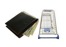 Wózek na zakupy, portfla i amerykanina dolary Fotografia Royalty Free