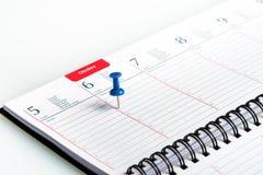 Wöchentliche Tagesordnung mit Spirale und Stift Stockbilder
