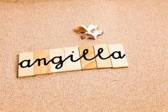 Wörter auf Sand angilla Stockfotos