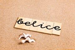 Wörter auf Sand belice Stockbild