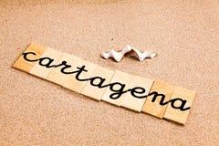 Wörter auf Sand Cartagena Stockbilder