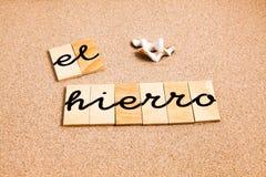 Wörter auf Sand-EL-hierro Stockbilder