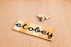Wörter auf Sand elobey Stockfoto