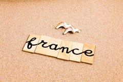 Wörter auf Sand Frankreich Lizenzfreies Stockbild