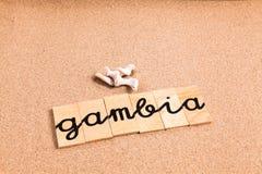 Wörter auf Sand Gambia lizenzfreie stockfotografie