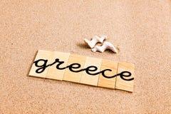 Wörter auf Sand Griechenland lizenzfreie abbildung