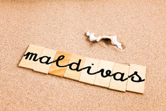 Wörter auf Sand maldivas Stockbild