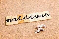 Wörter auf Sand maldivas Stockbilder