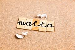 Wörter auf Sand Malta Lizenzfreie Stockbilder