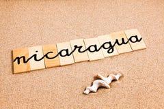 Wörter auf Sand Nicaragua Stockfotos