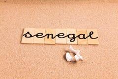 Wörter auf Sand Senegal stockfotografie