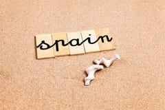 Wörter auf Sand Spanien Lizenzfreies Stockfoto