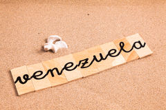Wörter auf Sand Venezuela Stockbild