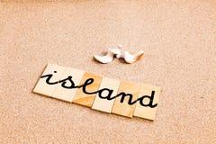 Wörter auf Sandinsel lizenzfreies stockfoto