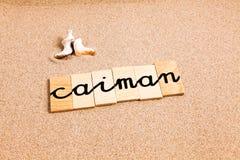 Wörter auf Sandkaiman lizenzfreies stockfoto