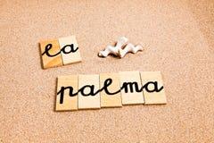 Wörter auf Sandla palma Lizenzfreie Stockfotografie