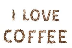 Wörter gebildet von den Kaffeebohnen Lizenzfreies Stockbild