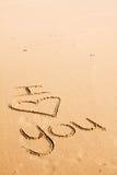 Wörter geschrieben in den Sand Lizenzfreie Stockbilder