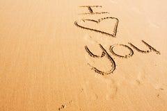 Wörter geschrieben in den Sand Lizenzfreie Stockfotos