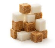 Würfel des Stocks und des raffinierten Zuckers Lizenzfreie Stockfotografie