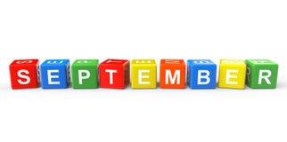Würfel mit September-Zeichen Stockfotos